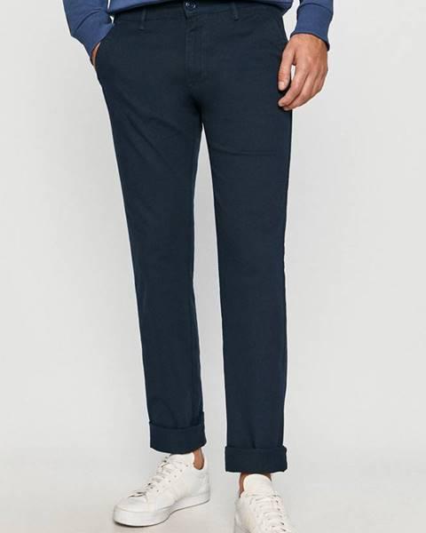 Tmavomodré nohavice Cross Jeans